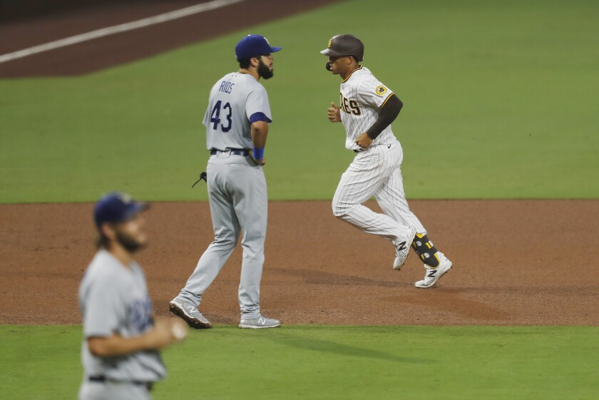 Trent Grisham of the Padres rounds the bases after hitting a home run in the sixth inning.