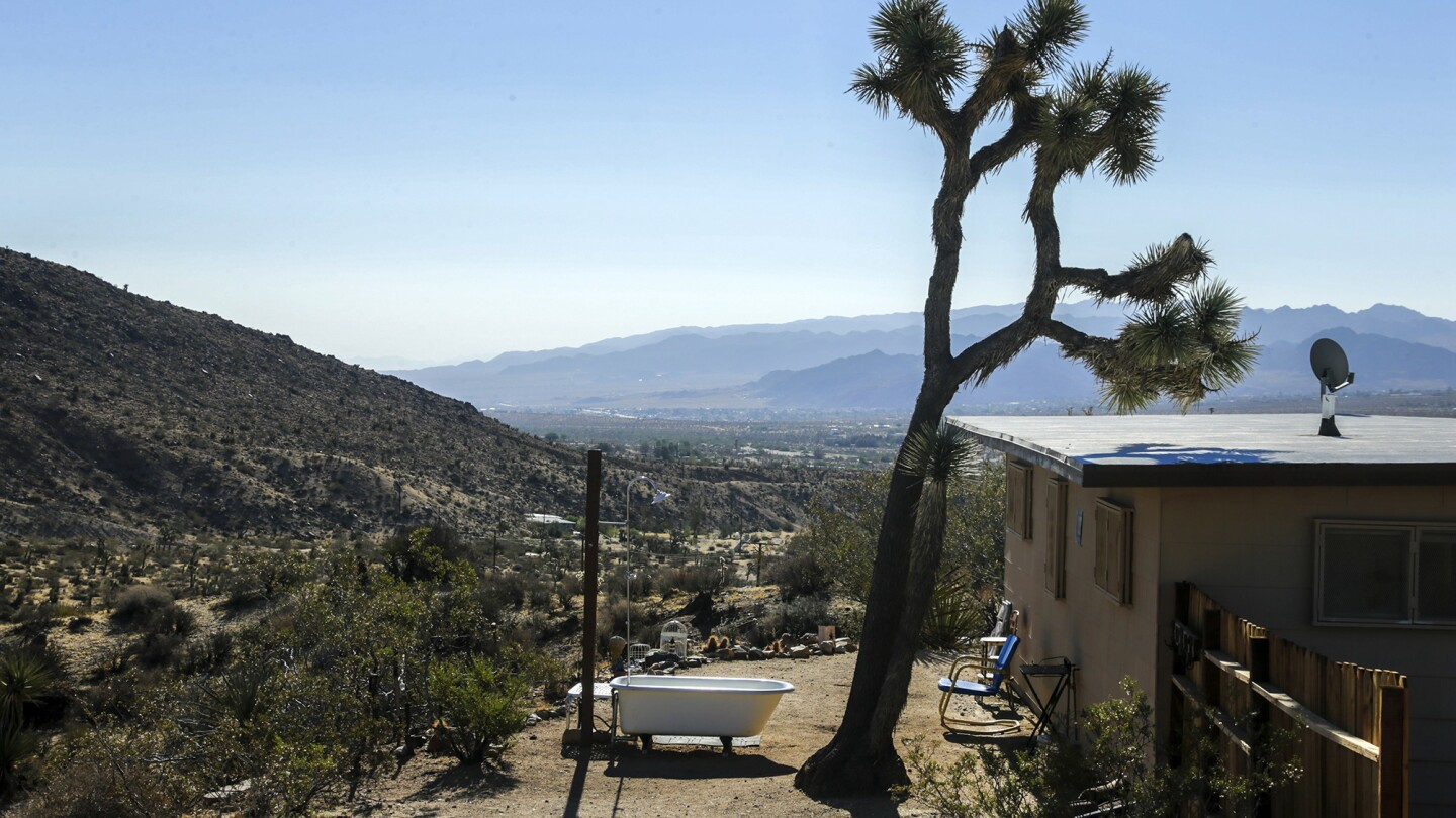 A tiny Yucca Valley homestead cabin, complete with outdoor bathing facilities, is proving popular with renters and providing unexpected income for owners Anne and Darryl Krieghoff.