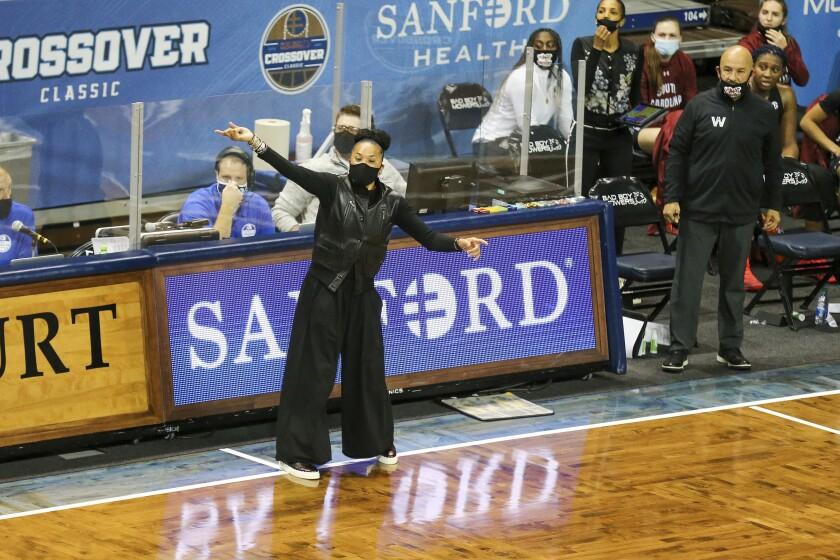 South Carolina head coach Dawn Staley yells at her team during the first half of an NCAA college basketball game against Gonzaga on Sunday, Nov. 29, 2020, in Sioux Falls, S.D. (AP Photo/Josh Jurgens)