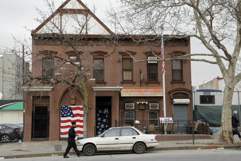 A man walks to his car in front of an American Legion Post, Tuesday, Feb. 9, 2016, in the Brooklyn borough of New York. A military author says it's time to find precisely where scores of Maryland soldiers are buried in the city so a monument can be erected on the spot to honor their sacrifice durin