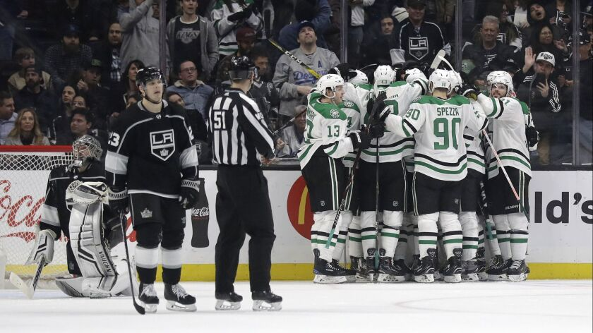 Dallas Stars players celebrate a 4-3 overtime win over the Los Angeles Kings in an NHL hockey game T