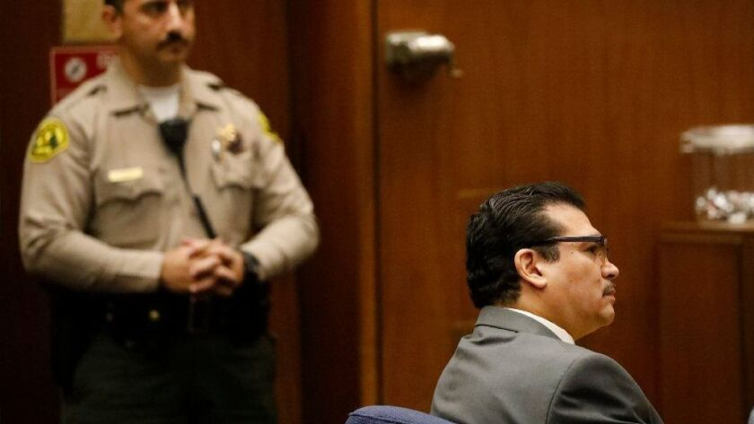 Paul Gonzales, a 1984 Olympic boxing champion and county-employed boxing coach, appears in Los Angeles Superior Court for a preliminary hearing Friday. He faces eight felony counts, including lewd acts on a child.