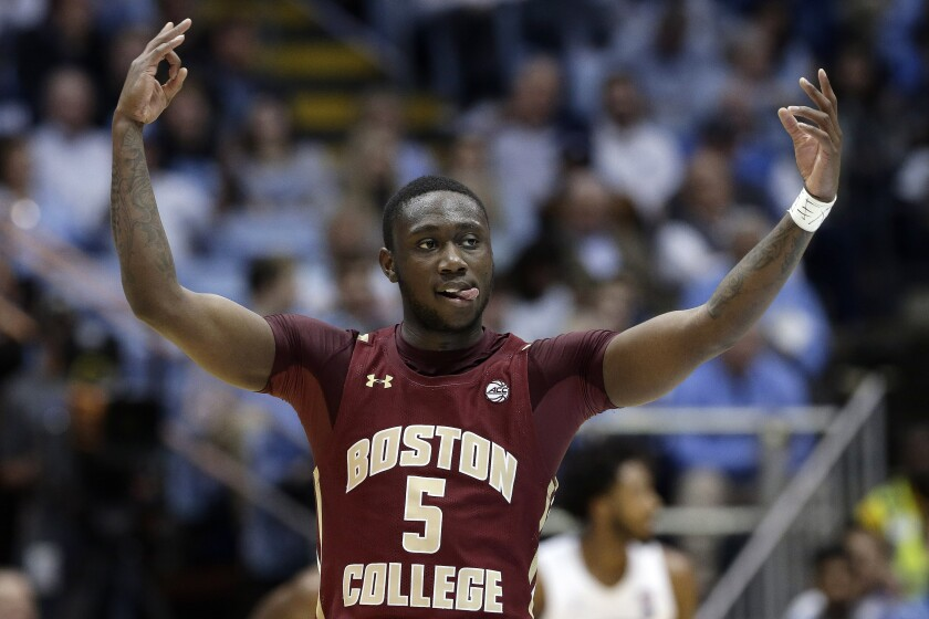 Boston College guard Jay Heath (5) reacts following a basket during the first half of an NCAA college basketball game against North Carolina in Chapel Hill, N.C., Saturday, Feb. 1, 2020. (AP Photo/Gerry Broome)