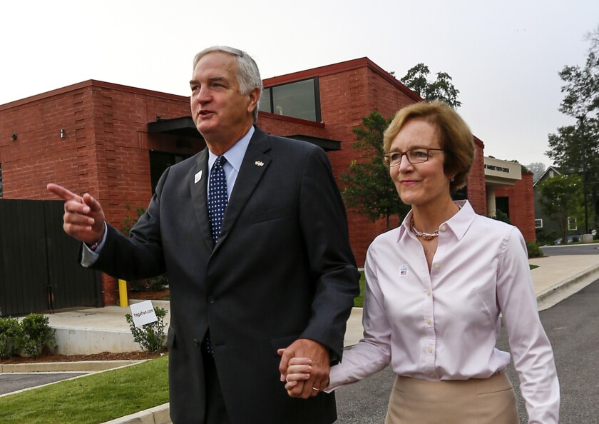 Sen. Luther Strange and his wife, Melissa, after voting Tuesday in Homewood, Ala.