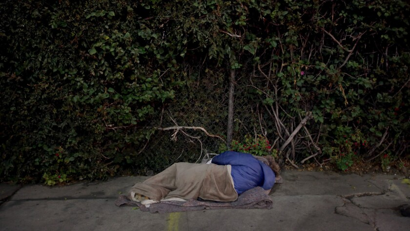 """Rachel """"Raquel"""" Phillips sleeps at Highland and Franklin, one of the busiest intersections in Hollywood."""