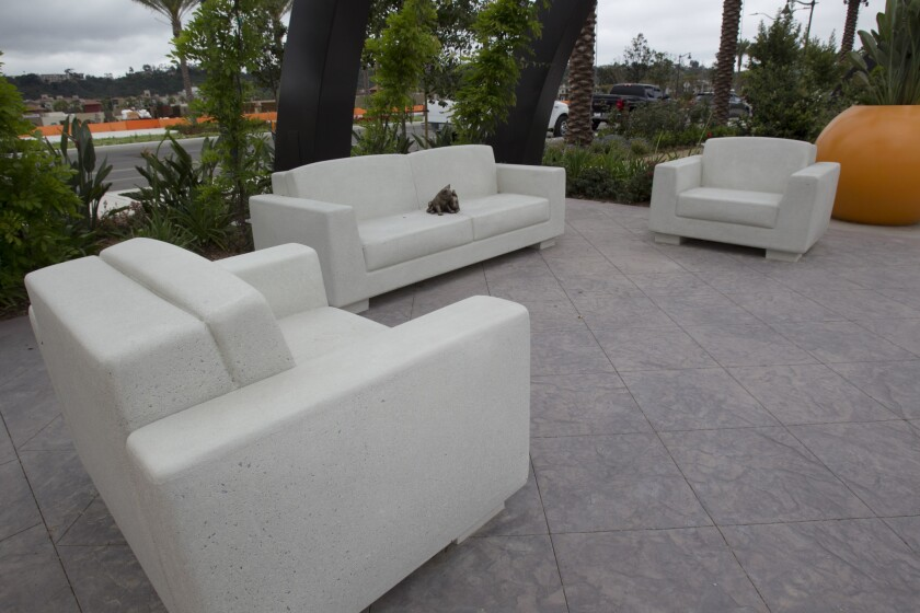 Concrete sofa and chairs are one of the unique features of the park. A bronze rabbit sits in the mid