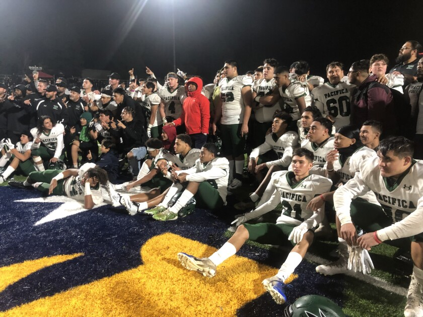Oxnard Pacifica players celebrate their 2-A bowl victory over Birmingham on Dec. 7, 2019.