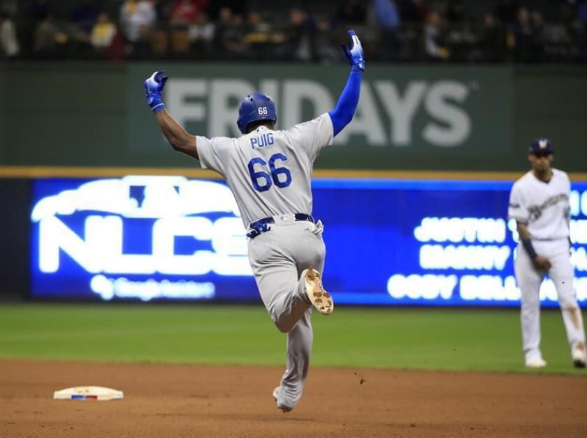 Los Angeles Dodgers right fielder Yasiel Puig (L) reacts while rounding second base after hitting a three-run home run off Milwaukee Brewers relief pitcher Jeremy Jeffress during the sixth inning of the National League Championship Series' Game 7 at Miller Park in Milwaukee, Wisconsin, USA, on Oct. 20, 2018. EPA-EFE/TANNEN MAURY