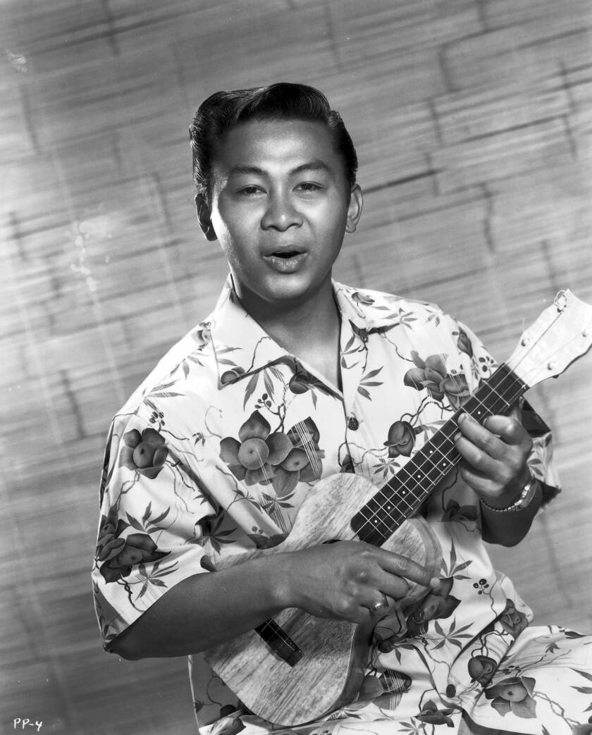"""The Hawaii-born Ponciano Ponce, a costar in television's """"Hawaiian Eye"""" series, in 1961, playing his trademark ukulele."""