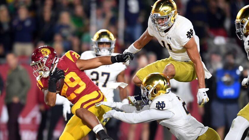 USC running back Vavae Malepeai scores a touchdown against Notre Dame.