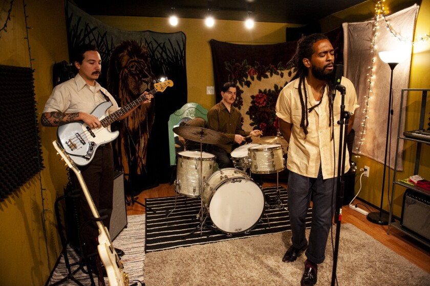 The group practices at Alex Garcia's home studio in Chula Vista, decorated with various blankets, rugs and light fixtures.