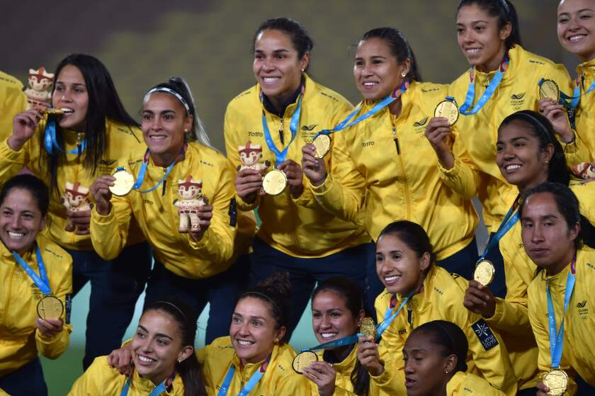 Colombia's players pose on the podium with their gold medals after defeating Argentina during their Women's Gold Medal Football Match of the Lima 2019 Pan-American Games in Lima on August 9, 2019. (Photo by CRIS BOURONCLE / AFP)CRIS BOURONCLE/AFP/Getty Images ** OUTS - ELSENT, FPG, CM - OUTS * NM, PH, VA if sourced by CT, LA or MoD **