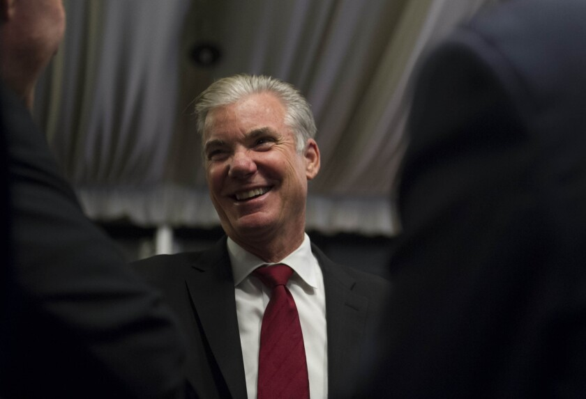 Superintendent of Public Instruction Tom Torlakson greets supporters during an election night watch party at the Citizen Hotel in Sacramento.