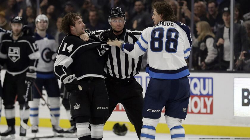 Kings' Brendan Leipsic, left, and Winnipeg Jets' Nathan Beaulieu (88) are separated by a referee during the second period.