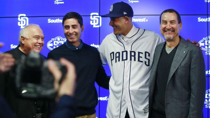 From left: Padres Chairman Ron Fowler, General Manager A.J. Preller, infielder Manny Machado and General Partner Peter Seidler celebrate the $300 million deal Friday after a press conference in Peoria, Ariz.