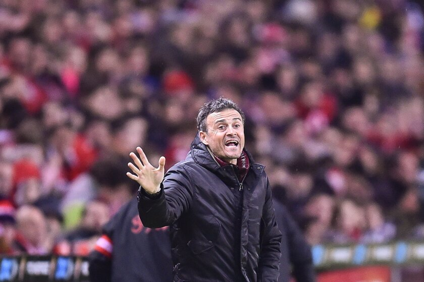 FC Barcelona's  head coach Luis Enrique, gives instructions during their Spanish La Liga soccer match between Sporting de Gijon and FC Barcelona, at El Molinon stadium, in Gijon, northern Spain, Wednesday, Feb.17, 2016. (AP Photo/Alvaro Barrientos)