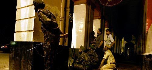 Indian soldiers keep watch on the Taj Mahal hotel in Mumbai on Friday morning.