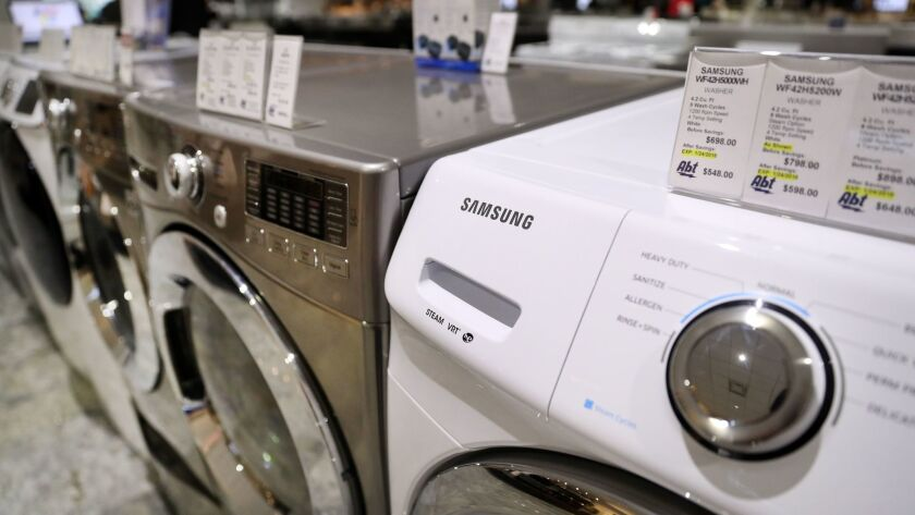 Samsung and LG washing machines on display at Abt Electronics in Glenview on Tuesday, January 23, 2018.
