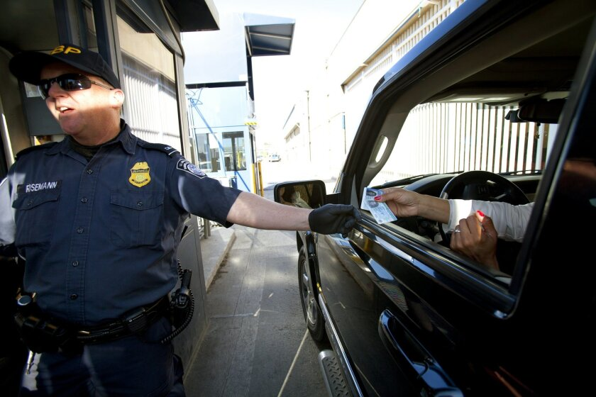At the San Ysidro Port of Entry, a CBP Officers checks the identification cards on northbound motorist utilizing the sentry lanes.