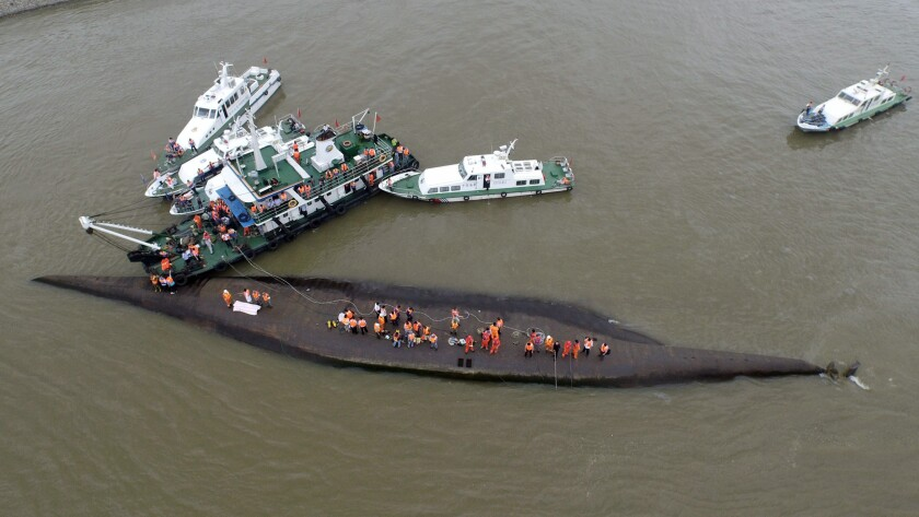 Rescuers search for survivors from a capsized ship in the Yangtze River on June 2.