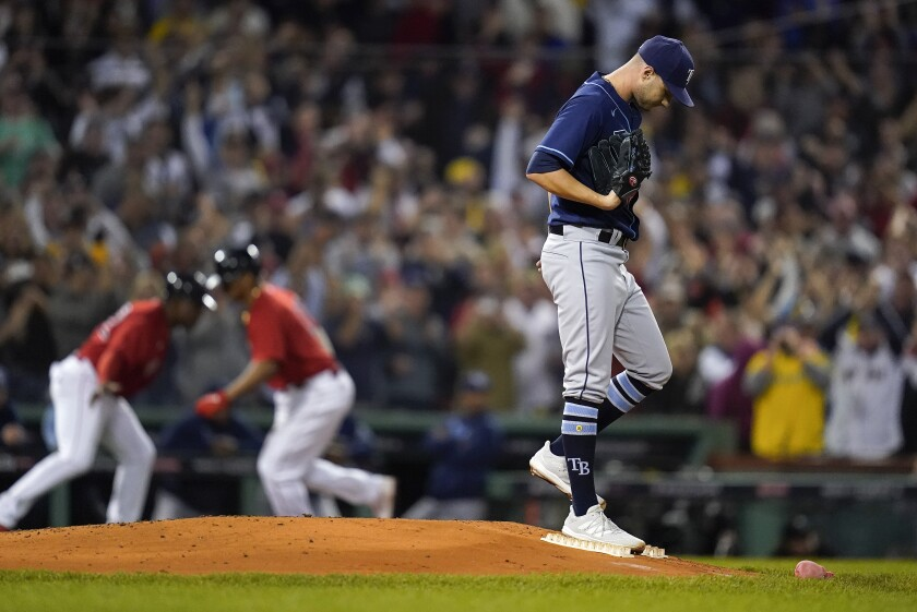 Tampa Bay Rays pitcher Shane McClanahan reacts after giving up a three-run home run during the third inning to the Boston Red Sox during Game 4 of a baseball American League Division Series, Monday, Oct. 11, 2021, in Boston. (AP Photo/Charles Krupa)
