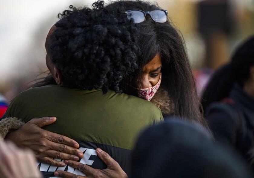 Angela Harrelson, aunt of George Floyd, is embraced at George Floyd Square.