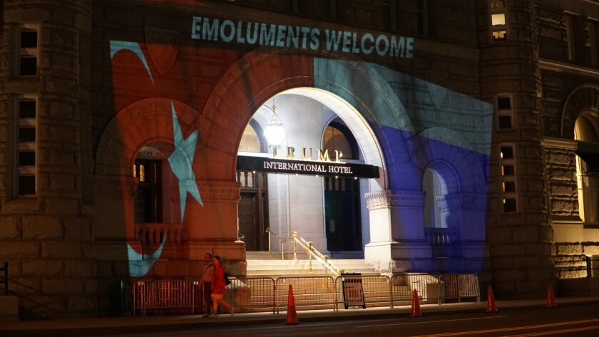 Artist Robin Bell's projections against the Trump International Hotel in Washington, D.C.