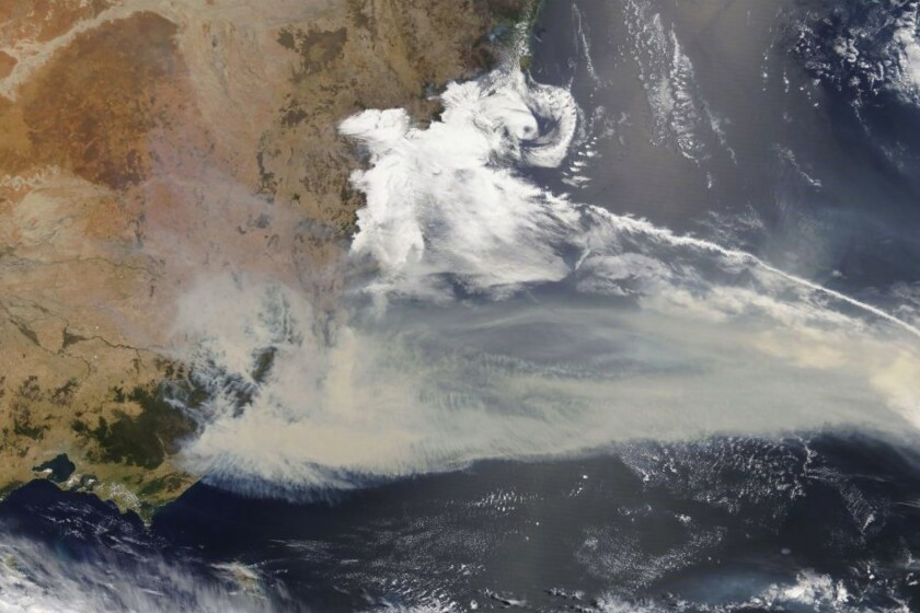 This Jan 2, 2020, photo captured by NASA's Terra satellite and made available by the Moderate Resolution Imaging Spectroradiometer (MODIS), shows thick smoke blanketing southeastern Australia along the border of Victoria and New South Wales. More than 200 fires are burning in Australia's two most-populous states. Blazes have also been burning in Western Australia, South Australia and Tasmania. (NASA via AP)