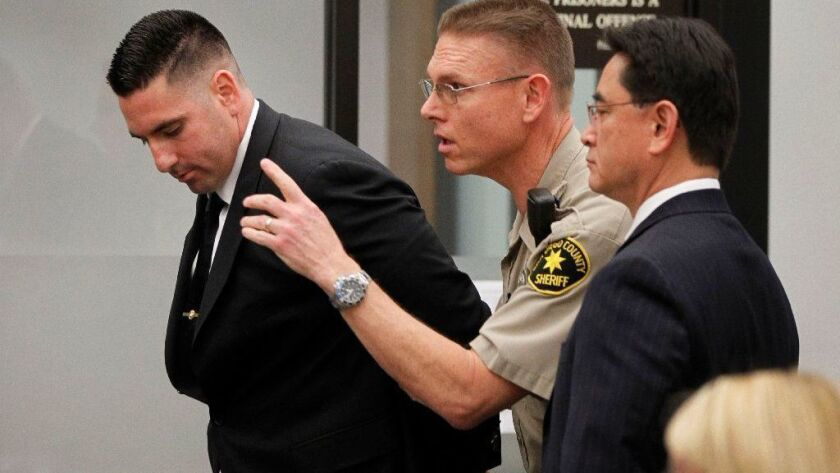 Civil lawsuits against Deputy Richard Fischer and San Diego County were put on hold by Superior Court Judge Katherine Bacal on Friday while the criminal case moves forward Fischer, above left, pleaded not guilty to 14 criminal charges at his February arraignment.