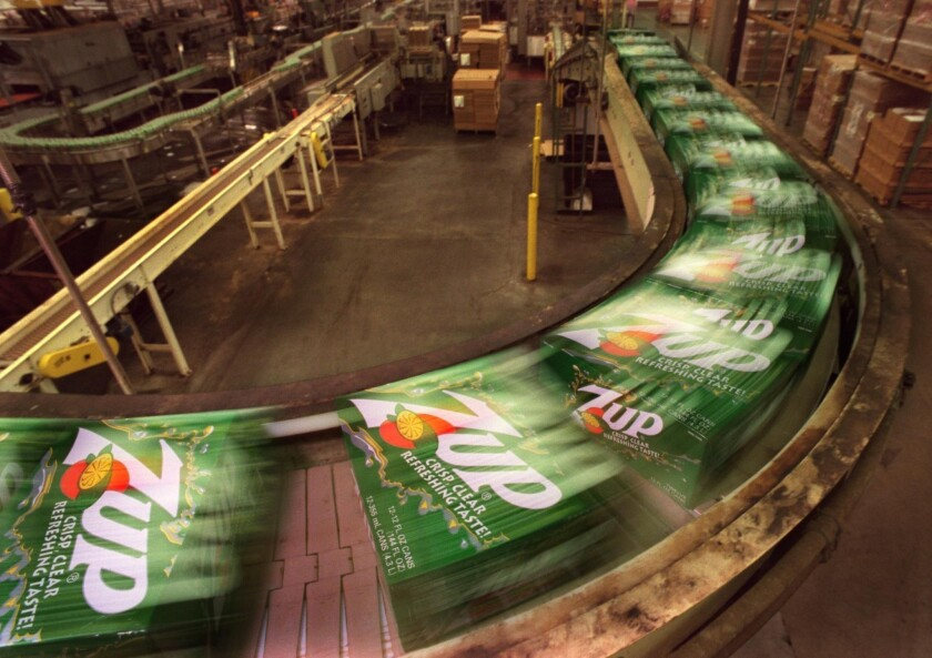 7-Up maker Dr Pepper Snapple Group agreed to stop adding vitamin E to its drinks and claiming antioxidant health benefits. Above, a file photo of a 7-Up bottling plant.