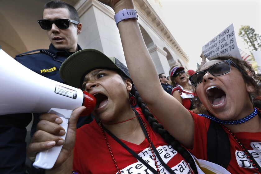 More than 1,500 people attend a May 1 rally on the steps of California's state Capitol in Sacramento demanding their civil liberties and the opening of the economy, closed due to the coronavirus.
