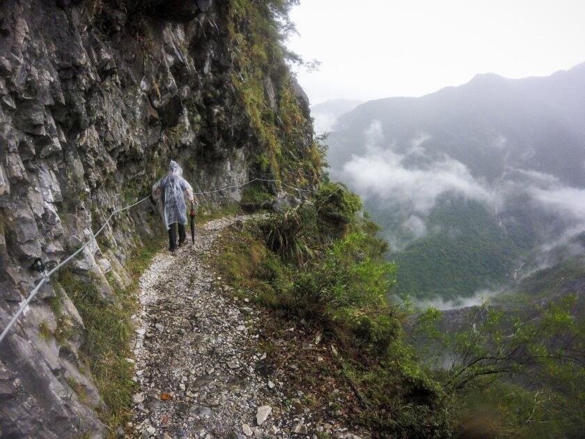 A guide hikes the Zhuilu Old Road trail in Taroko National Park, Taiwan.