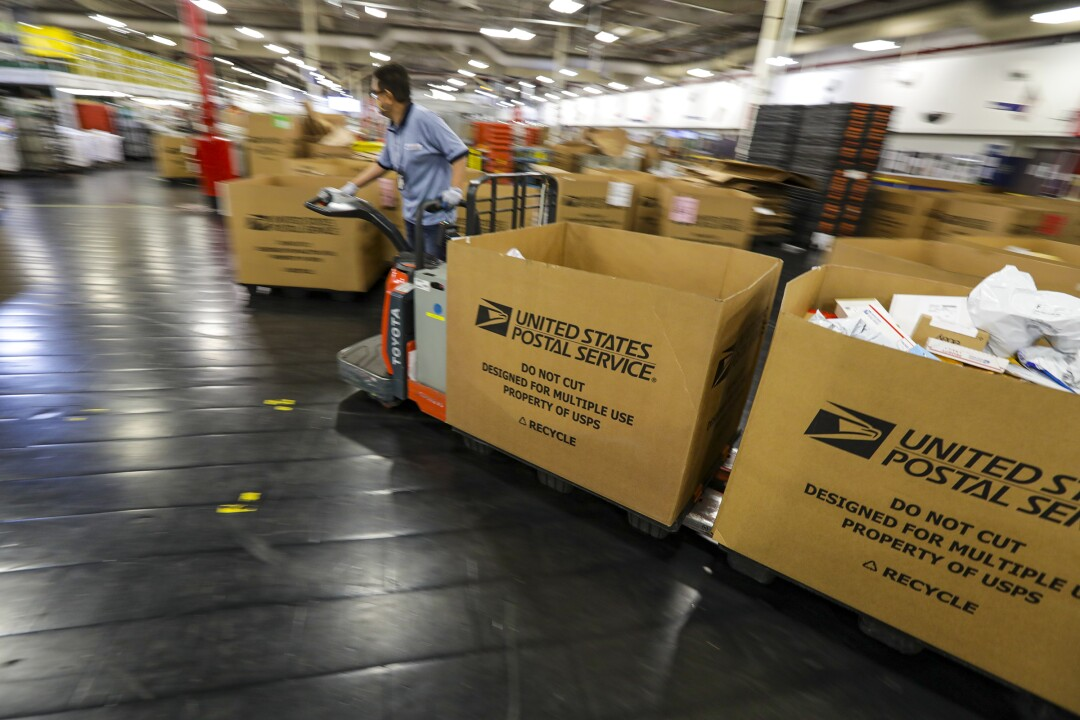 Packages and letters get ready for delivery at a processing and distribution center in City of Industry.