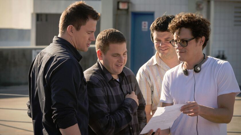 From left: Actors Channing Tatum and Jonah Hill work with directors Chris Miller and Phil Lord on th