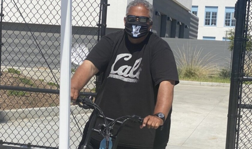 Venice football coach Angelo Gasca on his electric bike last spring. He likes his defense this fall.