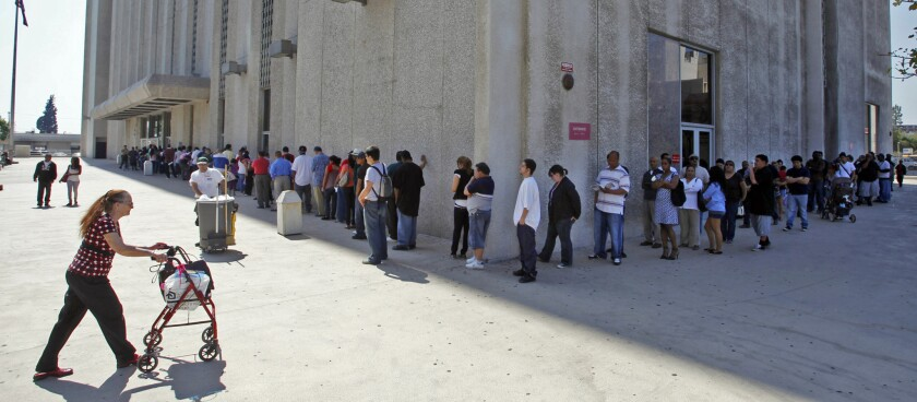 A line stretches around L.A.'s traffic court building in 2010.