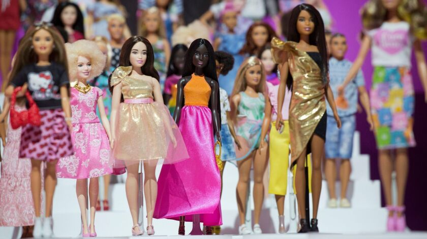 FILE- In this Feb. 20, 2018, file photo dozens of Barbie dolls are displayed at the Mattel showroom