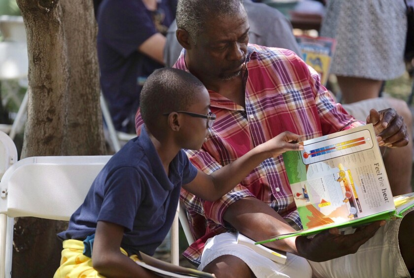 Families enjoy books together at Festival of Books.