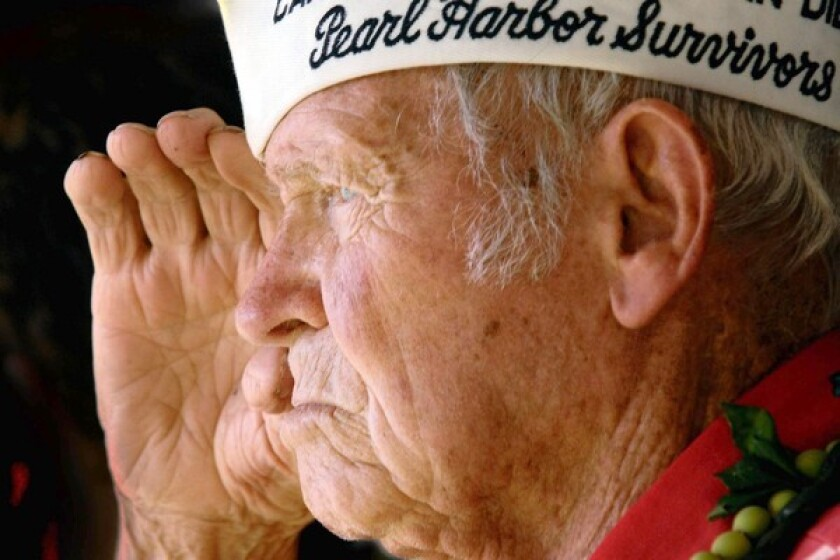 In this Dec. 7, 2006, photo, John Finn salutes at the groundbreaking ceremony for the USS Oklahoma memorial at Pearl Harbor.