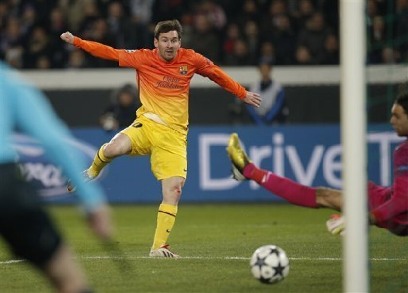 Barcelona's Lionel Messi scores the opening goal while Paris Saint Germain's goalkeeper Salvatore Sirigu of Italy looks on during their Champions League quarterfinal soccer match in Paris,Tuesday, April 2, 2013. (AP Photo/Christophe Ena)..