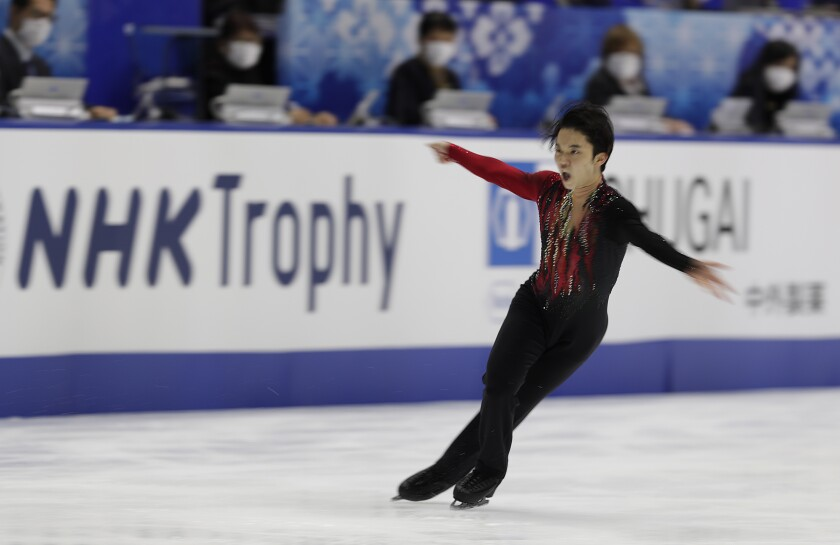 Kazuki Tomono of Japan performs during a free skating of an ISU Grand Prix of Figure Skating competition in Kadoma near Osaka, Japan, Saturday, Nov. 28, 2020. (AP Photo/Hiro Komae)