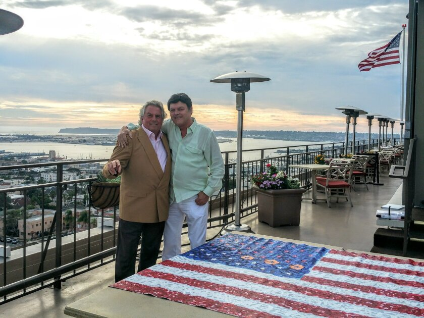 Mille Fleurs owner Bertrand Hug added his fingerprints to the Flag for Hope, with Flag for Hope representative Tim Shanahan of Rancho Santa Fe. Courtesy photo
