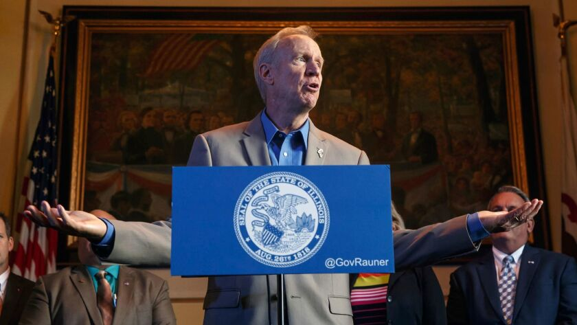 Illinois Gov. Bruce Rauner, shown in a file photo, argued that the minimum wage bill would hurt businesses and reduce jobs.