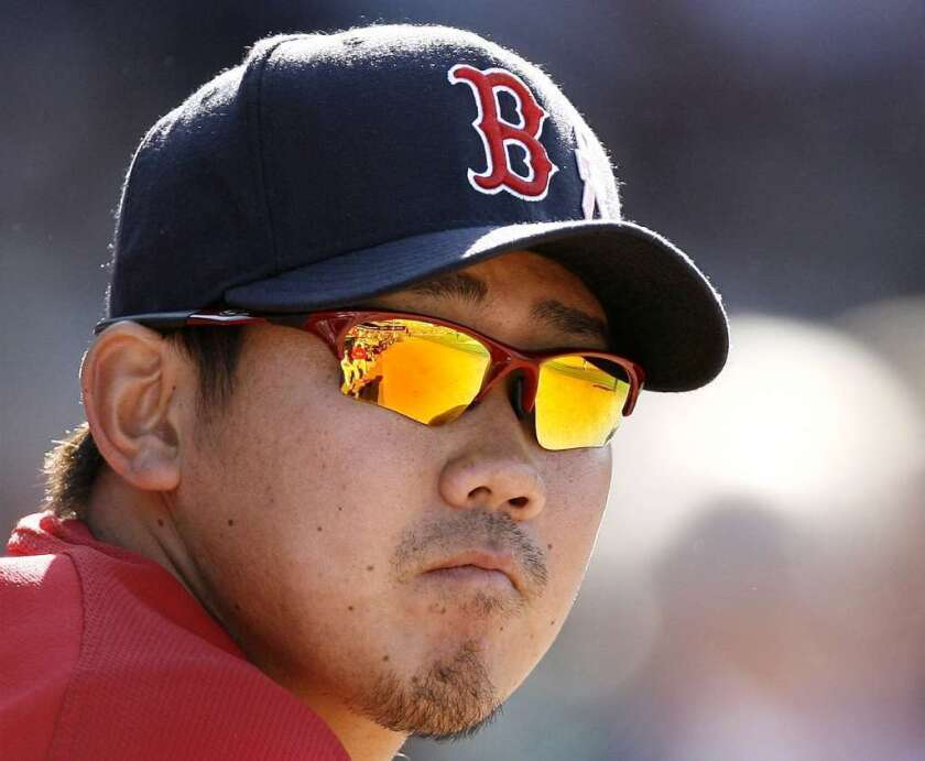 Boston Red Sox pitcher Daisuke Matsuzaka watches a game in 2007.