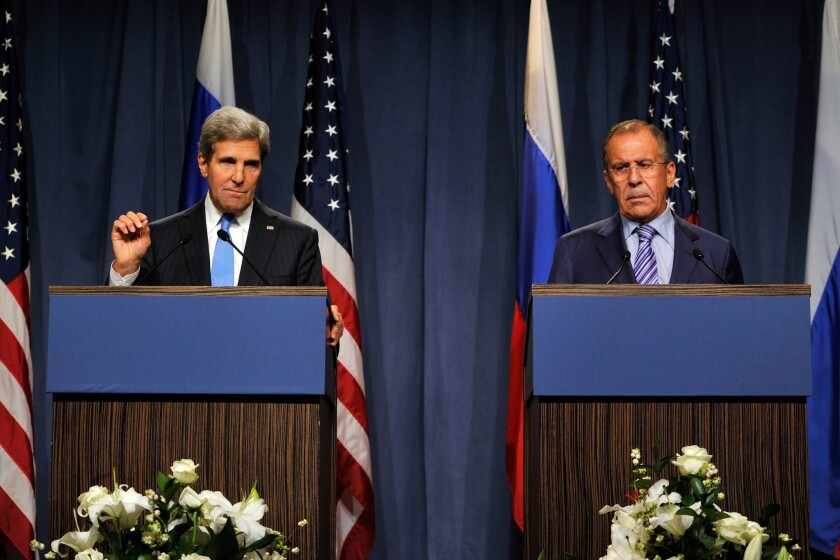 Secretary of State John F. Kerry, left, and Russian Foreign Minister Sergei Lavrov address reporters at a news conference in Geneva.