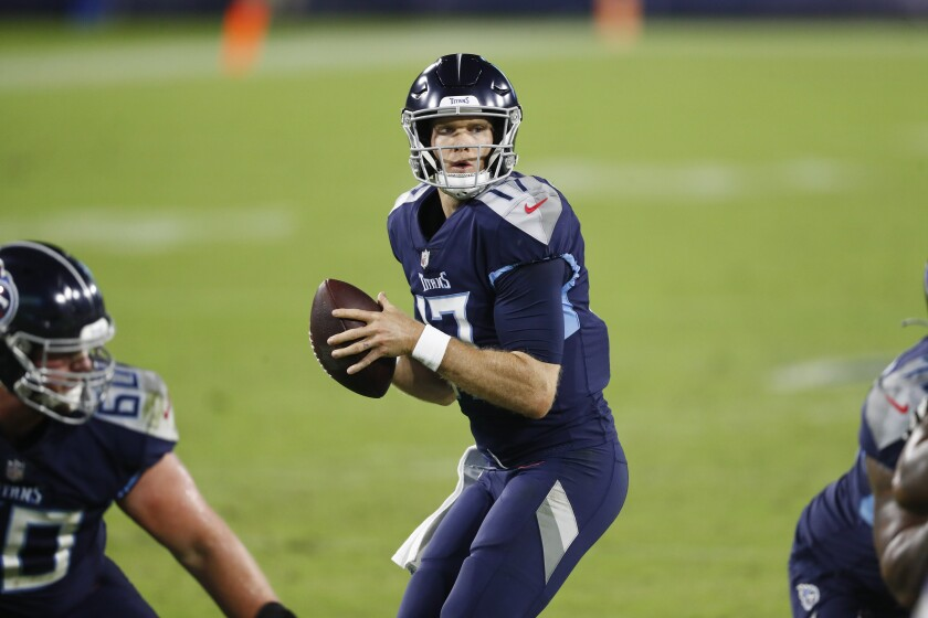 Tennessee Titans quarterback Ryan Tannehill looks for a receiver.