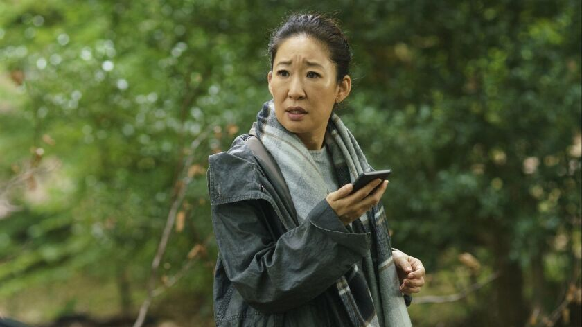 "This image released by BBC America shows Sandra Oh in a scene from ""Killing Eve."" On Thursday, Dec."
