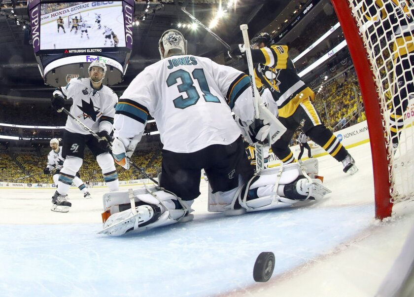 A puck shot by Pittsburgh Penguins' Conor Sheary rattles out of the net on the game-winning goal behind San Jose Sharks goalie Martin Jones during overtime in Game 2 of the NHL hockey Stanley Cup Finals on Wednesday, June 1, 2016, in Pittsburgh. The Penguins won 2-1 to take a 2-0 lead in the series