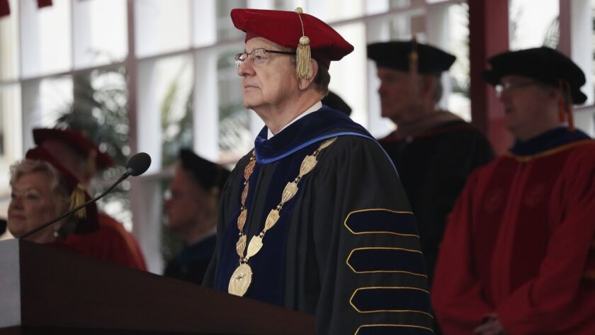 """USC President C.L. Max Nikias at a commencement ceremony on campus May 11. The university's Board of Trustees said late Friday that it would begin """"an orderly transition commence the process of selecting a new president."""""""