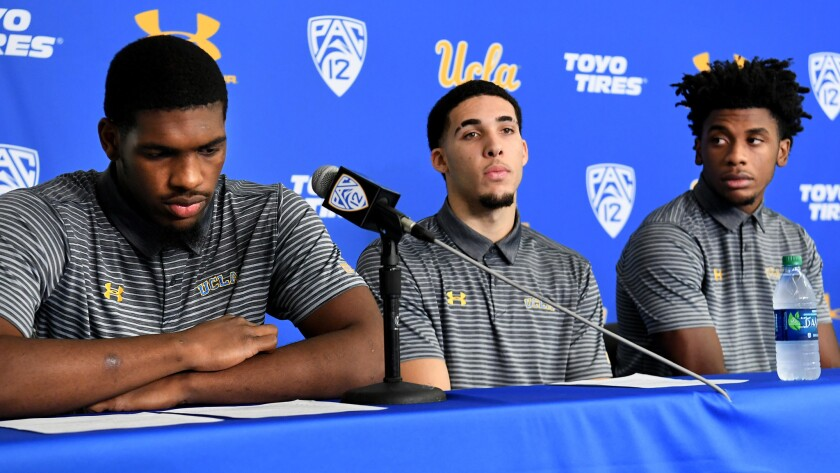 UCLA basketball players (from left) Cody Riley, LiAngelo Ball and Jalen Hill address the media on Wednesday.